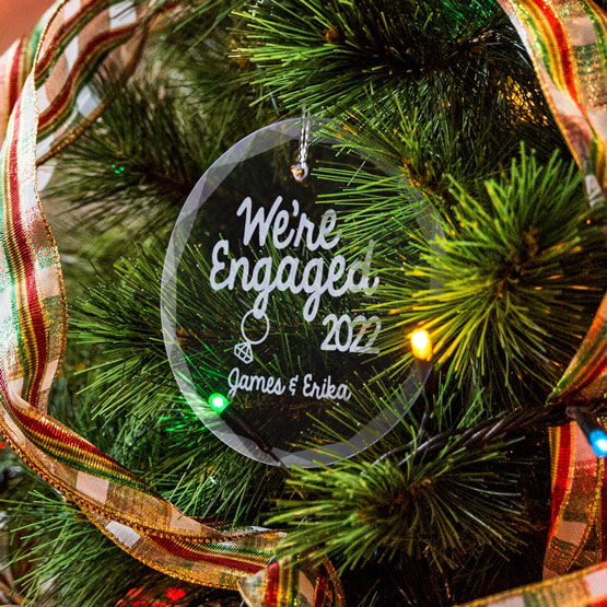 We're Engaged Glass Ornament